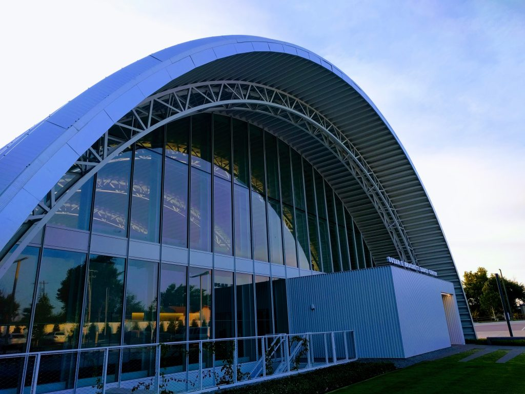 the outside of a dance center building with the facade as an oval shape
