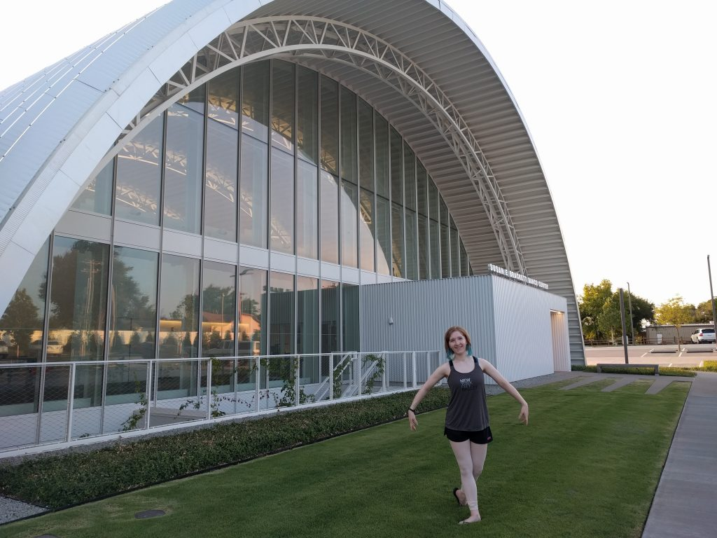 blogger pictured outside the same dance center building