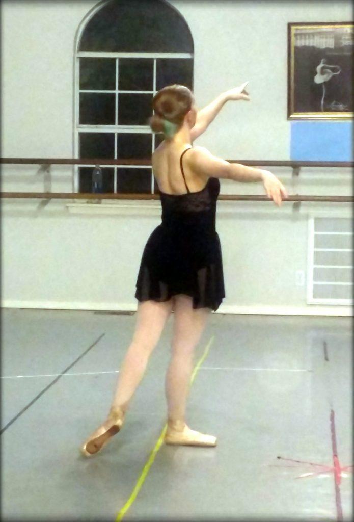 blogger in a ballet pose in her ballet studio
