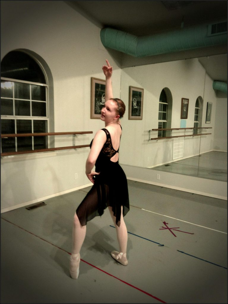 writer posing in her pointe shoes